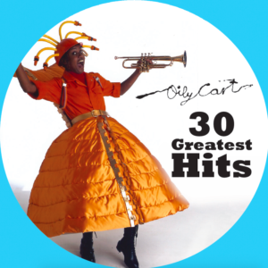 Circular image within blue border. The Oily Cart logo is above text that reads '30 Greatest Hits'. A performer wearing a big quilted orange skirt with an orange shirt and hat with orange tubes sticking out holds a trumpet and smiles at the camera.
