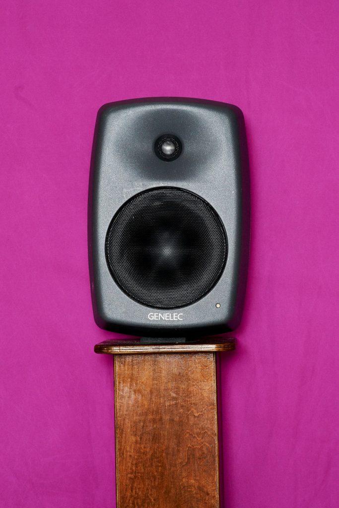Image of black speaker against pink background